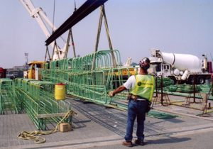 Worker Extending Length of Pier Replacement Pieces