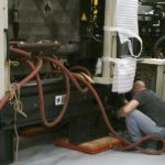 BAC technician at work on Energizer Schick machinery