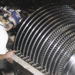 BAC technician at work on steam turbine