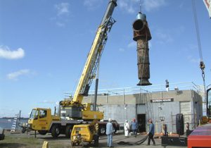 crane hauling old saltwater pump in New Haven, CT